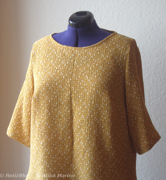 Bluse aus gelbem Musselinstoff